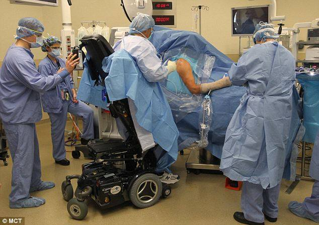 Ted Rammel: the surgeon operating in a wheelchair
